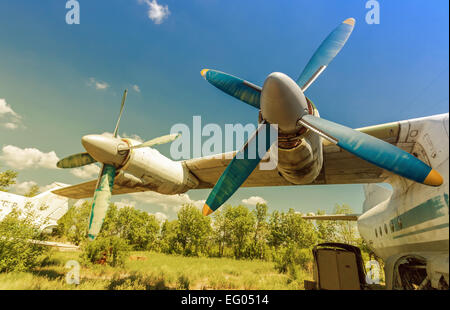 Turbines of turboprop aircraft at an abandoned aerodrome in sunny day - Stock Photo