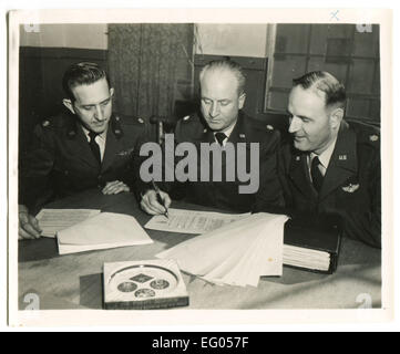 Usa. 12th Dec, 2014. CIRCA 1940s: Reproduction of an antique photo shows American officers at the headquarters sign - Stock Photo