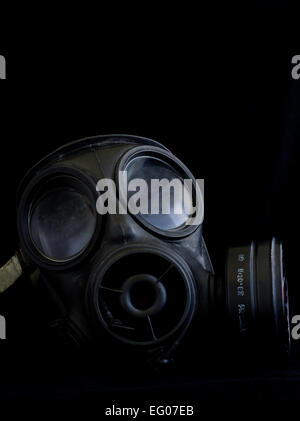 gas mask respirator on black background - Stock Photo