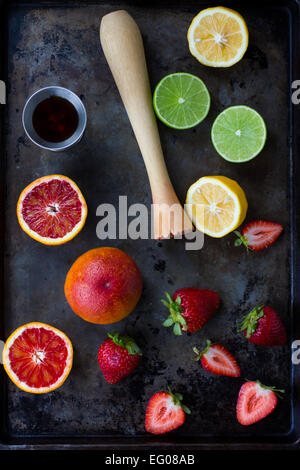 Blood orange, lemon, lime and strawberries on a baking tray - Stock Photo