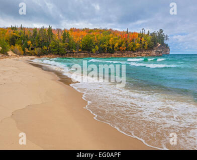 Pictured Rocks National Lakeshore, MI: Chapel Beach along Lake Superior with Grand Portal Point in fall color - Stock Photo