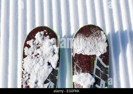 Skis in snow at Mountains in the alps - Stock Photo