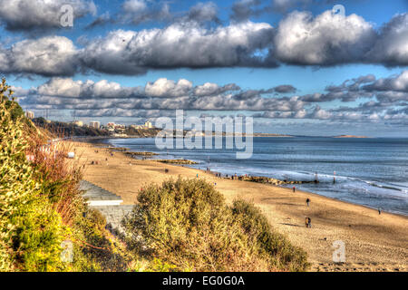 Branksome beach Poole Dorset England UK with cloudscape near to Bournemouth like painting in vivid bright colour - Stock Photo