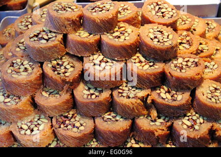 Tray of Burma Baklava, the traditional turkish sweet made with shredded fillo dough wrapped around a pistachios - Stock Photo