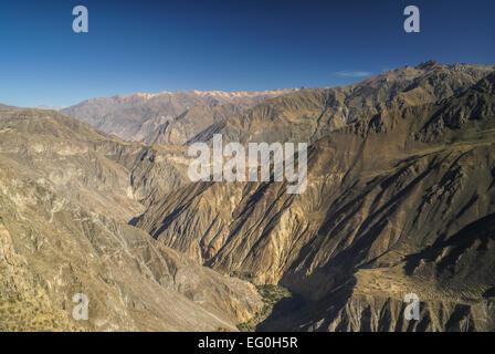 Picturesque view arid landscape around Canon del Colca, famous tourist destination in Peru - Stock Photo
