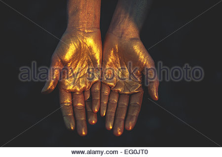 Close-up of woman's hands in cold color - Stock Photo