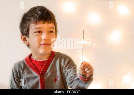 Bulgaria, Sofia, Young boy (4-5) looking at flare - Stock Photo