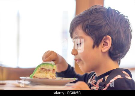 Bulgaria, Sofia, Young boy (4-5) eating cake - Stock Photo