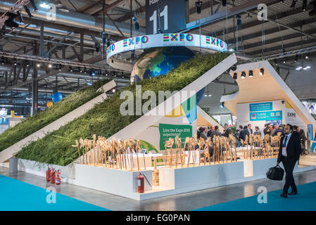 MILAN, ITALY: visitors walk in front of the Expo 2015 stand during BIT at Rho-Fiera in Milan on February 12, 2015 - Stock Photo