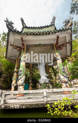Linh Ung Pagoda in Marble Mountains in Danang, Vietnam, Asia. The statue of goddess of compassion and mercy - Guanyin - Stock Photo