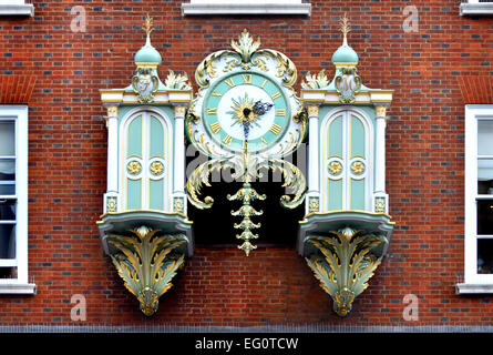 London, England, UK. Clock (1964) on the exterior of Fortnum and Mason's, Piccadilly. - Stock Photo