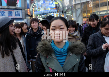 Crowds at the Sibuya crossing in front of Shibuya station. The crossing is reputed to be one of the world's busiest. - Stock Photo
