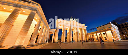 Germany, Berlin: Panoramic view of the nocturnal illuminated Brandenburger Tor - Stock Photo