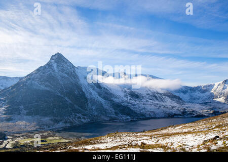View across Llyn Ogwen lake in Ogwen Valley to Tryfan and Glyderau from slopes of Pen Yr Ole Wen in winter. Snowdonia National Park (Eryri) Wales UK