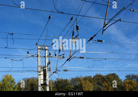 Railway infrastructure at Hitchin - overhead power supply wires and insulators - Stock Photo