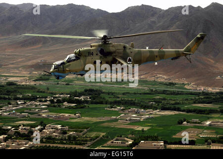 A photo taken from inside an MI-35 Hind E helicopter of another Afghan National Army Air Corps Mi-35 piloted by - Stock Photo