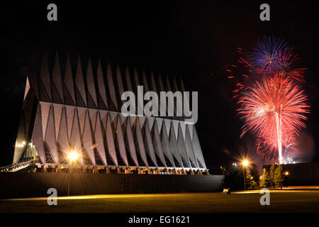 Fireworks explode beyond the Cadet Chapel as thousands braved severe weather to view the patriotic display at the - Stock Photo