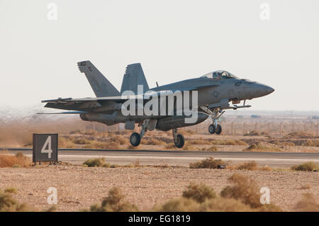 A US Navy F-18 Super Hornet from Naval Air Station Oceana, Virginia Beach, VA, takes off for a training mission - Stock Photo