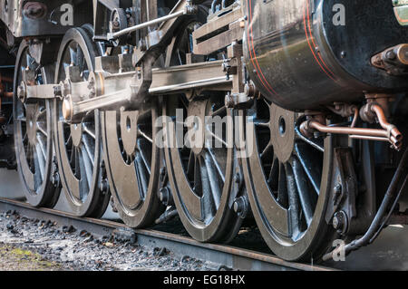 Wheels connecting rods and mechanism of a steam loco BR Standard Class 9F 2-10-0 loco - Stock Photo