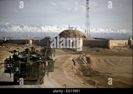 Members of a U.S. Army task force depart a dirt landing zone after securing the surrounding area in the Zabul province - Stock Photo