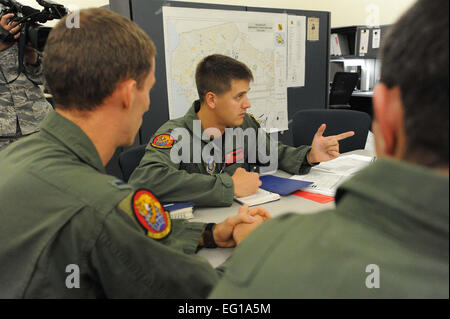 U.S. Air Force Capt. Nate Amidon, a 535th Airlift Squadron pilot, conducts a pre-flight crew briefing at Joint Base - Stock Photo