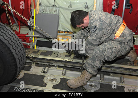 SPANGDAHLEM AIR BASE, Germany – A staff sergeant from the 52nd Logistics Readiness Squadron secures cargo inside - Stock Photo