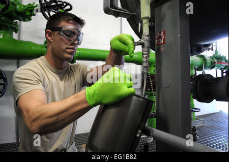 Senior Airman Lawson McLester, a fuel lab technician with the 31st Logistics Readiness Squadron at Aviano Air Base, - Stock Photo