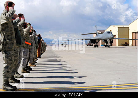 Airmen from the 28th Bomb Wing salute two returning B-1B Lancers as they taxi to their parking area on Ellsworth - Stock Photo