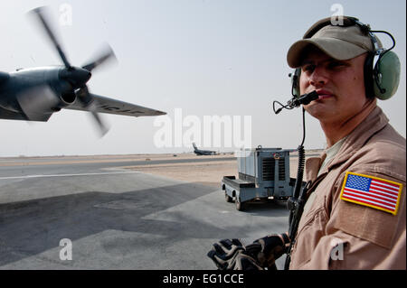 U.S. Air Force Staff Sgt. Tim Nicholas, a 746th Expeditionary Airlift Squadron loadmaster, starts the engines on - Stock Photo