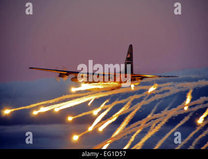 A U.S. Air Force C-130 Hercules cargo aircraft from Niagara Falls Air Reserve Station, N.Y., launches flares over - Stock Photo