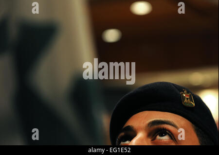 An Iraqi air force airman practices presenting the colors during joint honor guard training with Iraqi air force - Stock Photo
