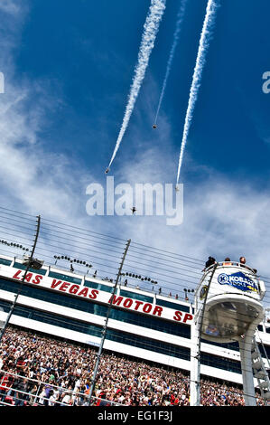 The U.S. Air Force Air Demonstration Squadron, the Thunderbirds, fly over the Las Vegas Motor Speedway during the - Stock Photo