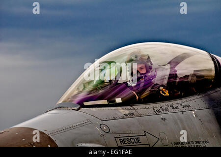 A 31st Fighter Wing F-16 Fighting Falcon pilot prepares his jet for de-arming after landing at Graf Ignatievo Air - Stock Photo