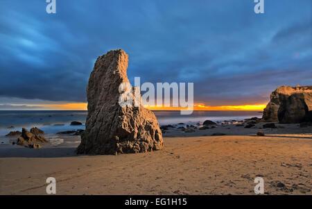 Malibu Beach with rocks, moody sky and incoming waves, in Los Angeles, California, USA - Stock Photo