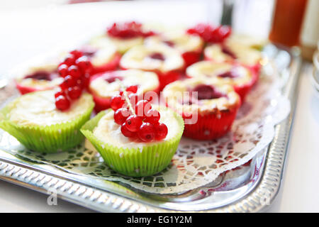 served different desserts with fruits on a tray - Stock Photo