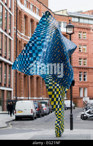 Blue and Yellow Checkered  sculpture in London England - Stock Photo