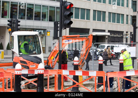 Men working on the Pavements in the City of London - Stock Photo