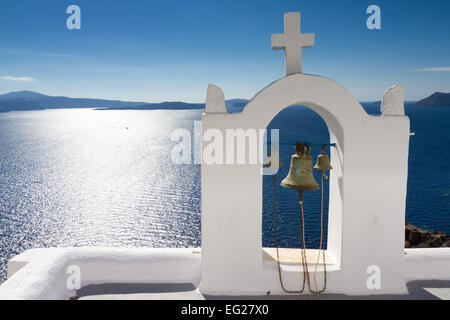 White bell tower at Oia, Santorini, Cyclades, Greece - Stock Photo