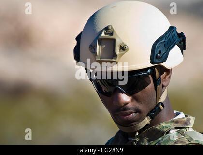 U.S. Air Force Staff Sgt. John Mitchell, 99th Civil Engineer Squadron explosive ordnance disposal technician, visually - Stock Photo