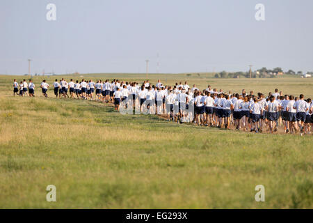 Airmen take to the trail during the monthly Warfit Run at Schriever Air Force Base, Colo., Aug. 9, 2012. Members - Stock Photo