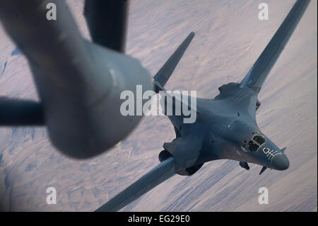 A B-1B Lancer approaches a KC-135 Stratotanker after being refueled during the Green Flag-West 13-2 exercise Nov. - Stock Photo