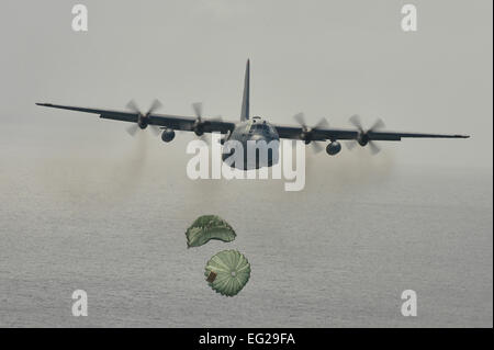 A C-130 Hercules airdrops supplies to Micronesian islanders during Operation Christmas Drop Dec. 16, 2013, near - Stock Photo