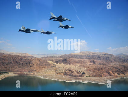 F-16 Fighting Falcons from the U.S. and Royal Jordanian air forces, as well as an F-18 Hornet from the U.S. Marine - Stock Photo