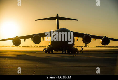An aircrew member from the 437th Airlift Wing boards a C-17 Globemaster III during a training exercise April 10, - Stock Photo
