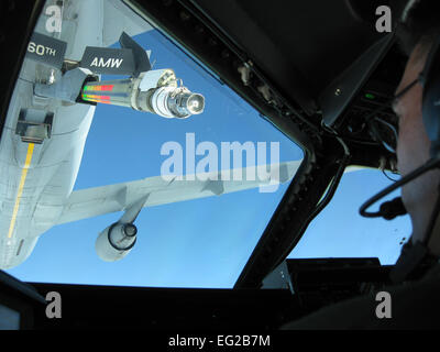An Air Force Reserve aircrew closes in for a refueling maneuver with a KC-10 Extender during the 349th Air Mobility - Stock Photo