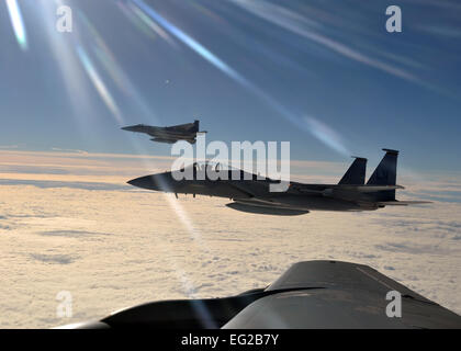 Two F-15C Eagles from the 48th Fighter Wing prepare to return to their simulated air combat portion of the Arctic - Stock Photo