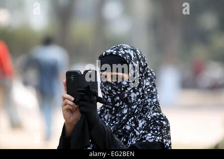 Dhaka 14 February 2015.Young Muslim Girls Taking Picture with cell phone at at Shohrawardi Uddan. in dhaka. - Stock Photo