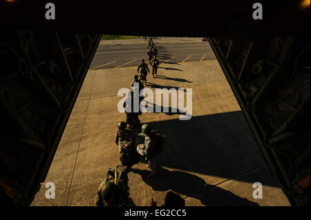 U.S. Army soldiers, 5th Special Forces Group, load onto a C-130J Super Hercules at Fort Campbell, Ky., May 20, 2014. - Stock Photo