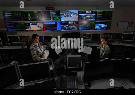 Staff Sgt. Alex Garviria and 2nd Lt. Rachel James work in the Global Strategic Warning and Space Surveillance System - Stock Photo