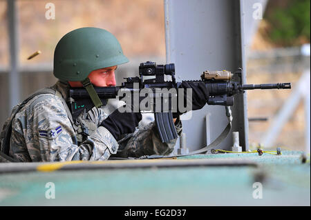 Airman 1st Class Charles Manarino zeroes in his weapon before a shooting exercise March 7, 2013, at the Jinjui Air - Stock Photo